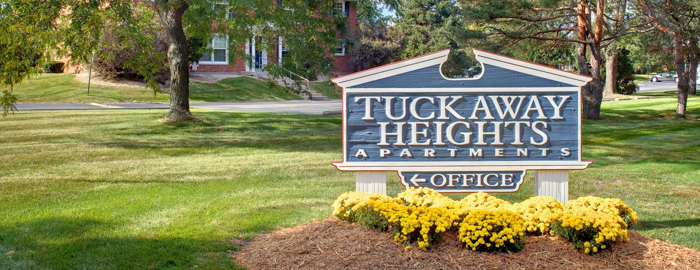 Tuckaway Heights apartments sign with flowers